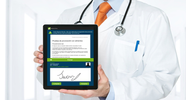 Signing on a tablet by a doctor
